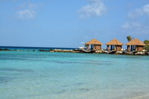 tiki huts - renaissance island - flamingo beach aruba